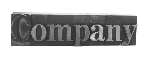 the word 'Company' in old, inkstained metal type