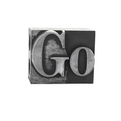 the word 'Go' in old, inkstained metal type