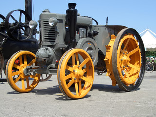 Older yellow grey tractor, front side