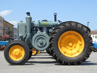 Old yellow grey tractor