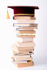 maste's cap with a books