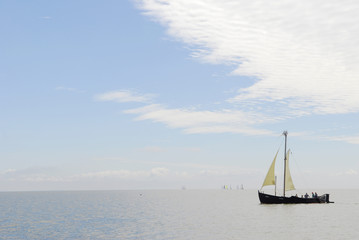 old ship sails in sea