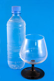 Bottle and glass of mineral water poster