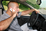 Businessman hold mobil phone during driving poster
