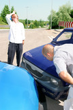 accident two cars, two mans looks at vehicle poster