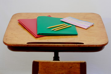 School supplies on old student desk
