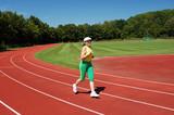 Active senior woman jogging in a stadium poster