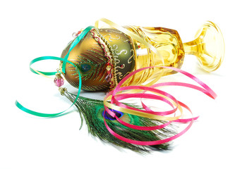Decorated egg peacock feather and wine glass