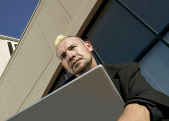 Punk Businessman with Laptop Computer