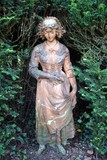 statue of a woman in garden carrying book poster