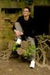 Grinning Teenager on Tree Stump