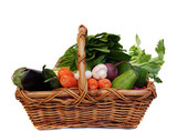 Vegetables in the basket isolated on white