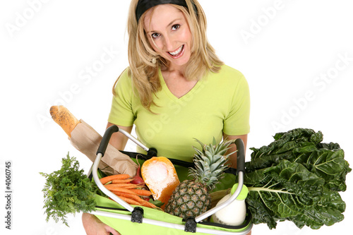 Female with eco shopping bag filled with groceries