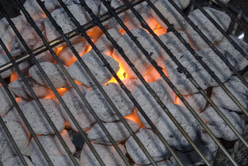 charcoals flaming in the grill