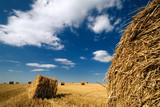 Perspective landscape with haystacks and blue sky