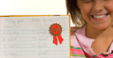 Young girl with spelling test poster