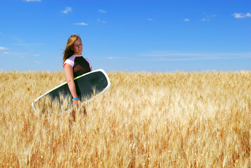 Prairie Boarder Girl in Wheat Field