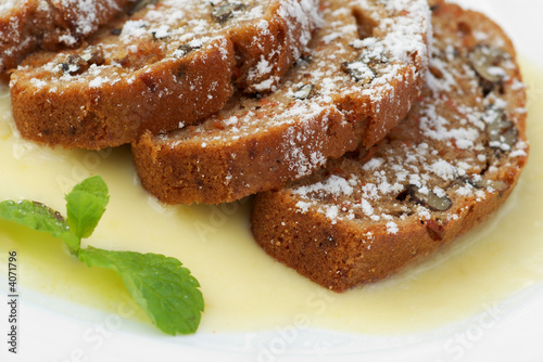 warm carrot cake with vanilla sauce