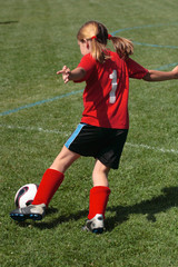 Youth Soccer or Football Player in Action 6