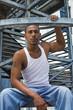 black guy sitting on stairs