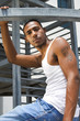black man on metal stairs