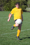 Youth Teen Soccer Player Kneeing Ball poster