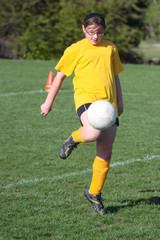 Youth Teen Soccer Player Kneeing Ball