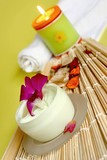 Moisturizing face cream with candles, dry blooms and white towel poster