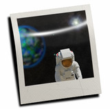 Polaroid slide with astronaut poster