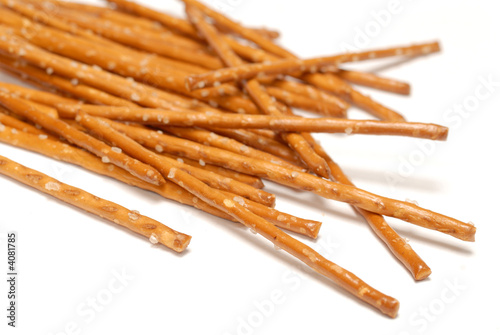 Salted pretzels isolated over white background
