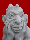 Statue/ sculpture of the devil/satan putting his tongue out poster