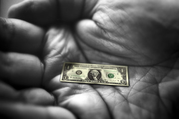 Hand with dollar note