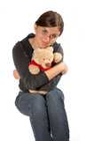 girl hugs her teddy tight, for comfort poster