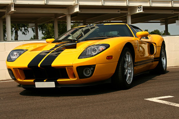 front of yellow supercar with black stripes