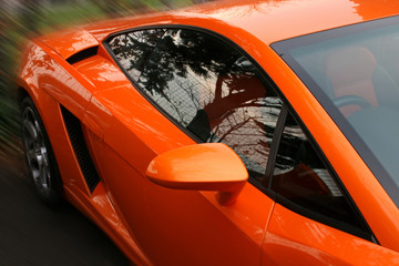 side of orange supercar