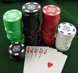 Full House of hearts winning hand at Poker