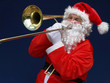 Santa playing silent night at christmas time