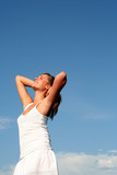 Woman stretching in sunlight poster