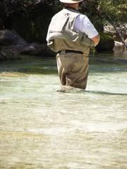 Senior angler in the stream