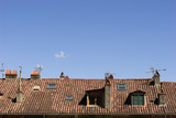 Chimneys, Antennas and red tile Roof poster