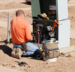 Electrician working on installation.