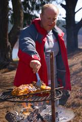 Man preaparing BBQ