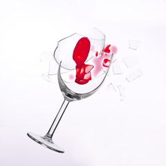 fallen wine glass with red wine in it