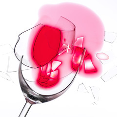 broken wine glass with red wine (macro)