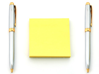 pens and yellow paper