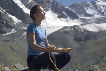 Girl with a rope in the mountains