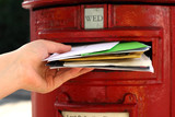 posting many letters to red british postbox on street poster