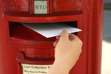 posting a  letter to red british postbox on street poster