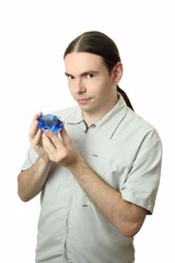 young man holding a crystal