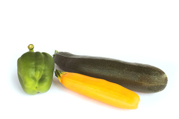 zucchini  and bell pepper isolated on white